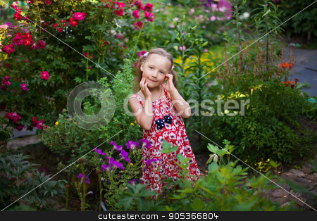 Cute happy girl in a green blooming garden stock photo, Cute happy girl in a blooming garden by HDesert