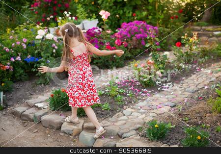 Running happy girl in a green blooming garden stock photo, Running happy girl in a blooming garden by HDesert