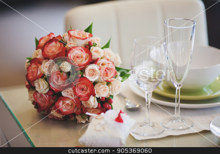 Beautiful wedding bouquet of pink and white rose on table stock photo, Beautiful wedding bouquet of pink and white rose on table with wineglasses by HDesert