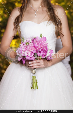 Beautiful pink peony wedding bouquet in bride's hands, closeup stock photo, Beautiful pink peony wedding bouquet in bride's hands, closeup, selective focus by HDesert
