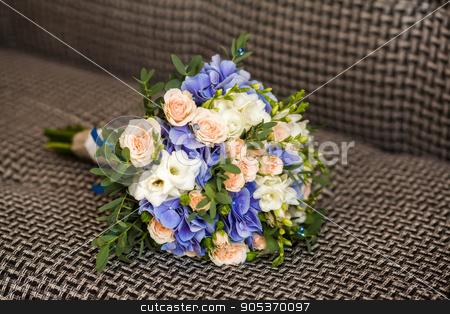 Close up of wedding bouquet on beige background stock photo, Close up of wedding bouquet, beige background by HDesert