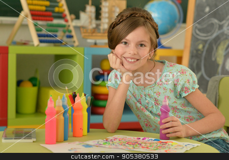 Little girl drawing at  home stock photo, Portrait of Little girl drawing at home by Ruslan Huzau