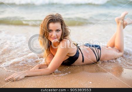 Girl have photosession on the beach stock photo, Girl have photosession on the beach with waves and sand by Elena Nichizhenova