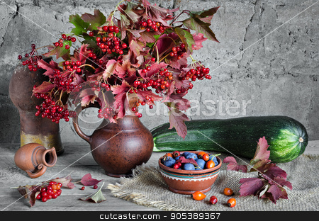 Vegetables and berries on the old boards  gray background stock photo, Vegetables and berries on the old boards and gray background in rustic style. Bouquet of viburnum in a jar, squash and sloe berries and rose hips by Galina Bondarenko