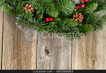 Christmas border with decorative wreath on rustic wooden boards stock photo, Christmas border with decorative wreath on rustic wooden boards.  by tab62