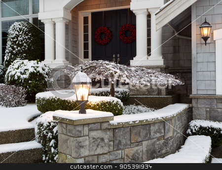 Front of Home during the Winter Holidays  stock photo, Closeup photo of home entrance during the holidays with fresh snow  by tab62
