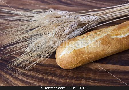 Fresh Bread stock photo, Fresh bread with wheat stalk on black walnut board by tab62