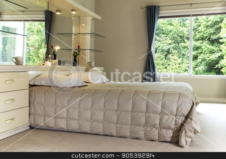 Master Bedroom with Large Window displaying Green Trees in backg stock photo, Master bedroom with king size bed, large mirror and open curtains showing green trees in background by tab62