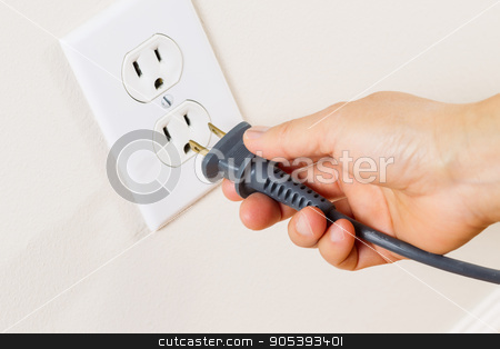 Inserting Power Cord Receptacle in wall outlet  stock photo, Horizontal photo of female hand inserting power cord receptacle into electric wall outlet  by tab62