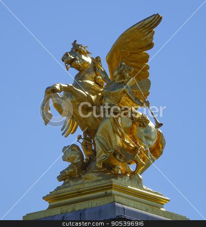 The golden statues on Alexandre III bridge in Paris stock photo, The golden statues on Alexandre III bridge in Paris by Erik Lattwein