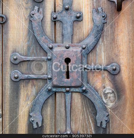 Keyhole of old doorlock stock photo, Keyhole of old doorlock in a wooden door by michaklootwijk