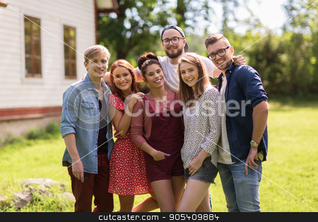 happy teenage friends hugging at summer garden stock photo, leisure, holidays, reunion, people and friendship concept - happy teenage friends hugging at summer garden party by Syda Productions