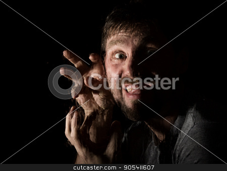 Dark portrait of scary bearded man with smirk, expresses different emotions. Drops of water on a glass, hand and male face stock photo, Dark portrait of scary bearded man with smirk, expresses different emotions. Drops of water on a glass, hand and male face. by Alexander
