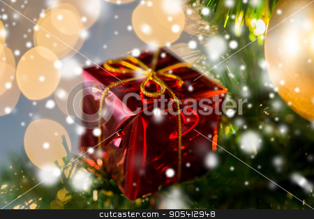 close up of gift box decoration on christmas tree stock photo, holidays, new year, decor and celebration concept - close up of red gift box decoration on christmas tree by Syda Productions