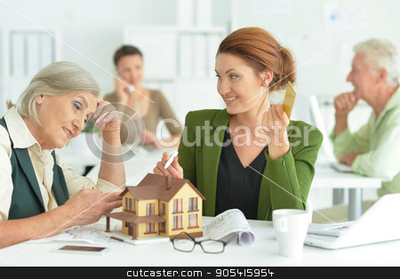 Portrait Of working  house agent  stock photo, Portrait Of working Female house agent and business people In Office by Ruslan Huzau