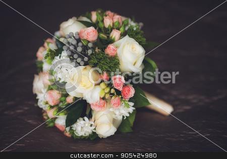 Close up of beautiful wedding bouquet on dark background stock photo, Close up of beautiful wedding bouquet, dark background by HDesert