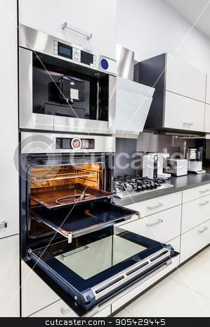 Modern hi-tek kitchen, oven with door open stock photo, Modern luxury hi-tek black and white kitchen, clean interior design, focu at oven with door open by Serghei Starus