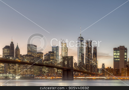 New York skyline with Brooklyn Bridge stock photo, Skyline of Lower Manhattan and Brooklyn Bridge during sunset time by Oliver Foerstner