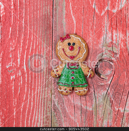 Gingerbread cookie on rustic red wooden boards  stock photo, Christmas holiday gingerbread cookie on rustic red wood.     by tab62