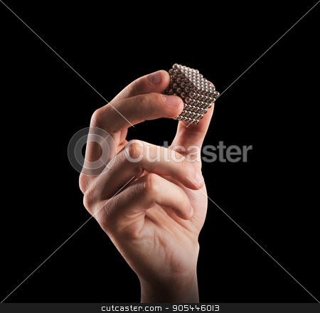 Build company stock photo, Cube of magnet spheres held by a hand. concept of union and partnership by Federico Caputo