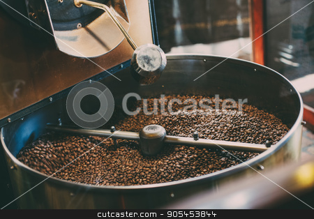 Roasted coffee in  roaster stock photo, Fresh Coffee Beans - Freshly roasted spinning cooler professional machine. by serkucher