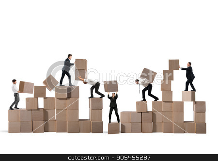 Team of businesspeople build a new company stock photo, Team of businesspeople build a construction with wood cubes by Federico Caputo