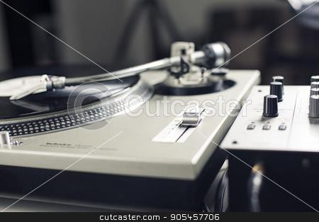 DJ mixer stock photo, DJ mixer with a vinyl record, close up by Ivan Kamzyst