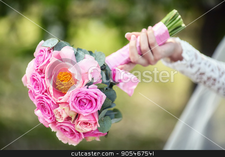 Close up of beautiful pink wedding bouquet stock photo, Close up of beautiful pink wedding bouquet in hand of bride by HDesert