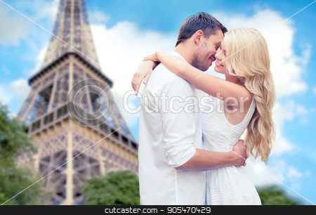 happy couple hugging over eiffel tower stock photo, travel, tourism, people, love and dating concept - happy couple hugging over eiffel tower in paris background by Syda Productions