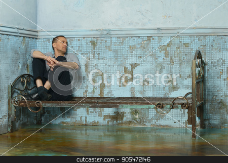 Man on metal rusty bed stock photo, Man on the metal rusty bed in prison by Ruslan Huzau
