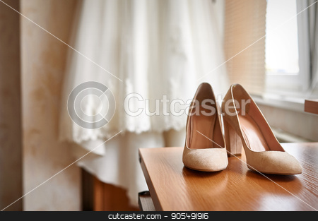 wedding shoes and bride in a bedroom stock photo, wedding shoes and bride in a bedroom by timonko