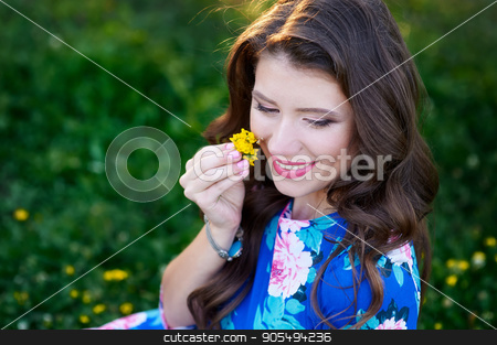 beautiful young woman holding a flower stock photo, beautiful young woman holding a flower in summer park by timonko