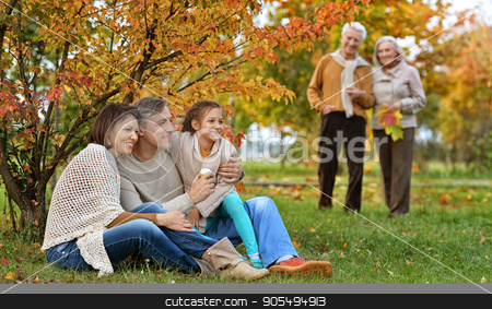 big family on picnic  stock photo, Portrait of a big family on picnic in autumn by Ruslan Huzau