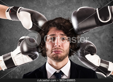 Punched guilty businessman stock photo, Angry People hit with punches a sad businessman by Federico Caputo