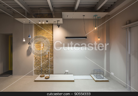 Loft style interior stock photo, Interior in a loft style with gray walls and a narrow brick wall. There is a yellow door, many different glowing lamps, design metal stool. Horizontal by bezikus