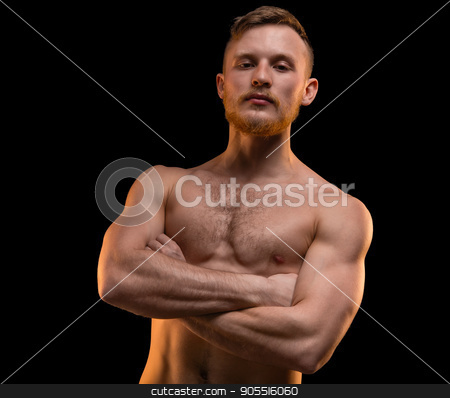 Muscular man with arms crossed stock photo, Muscular man with arms crossed on black background by Chris Tefme