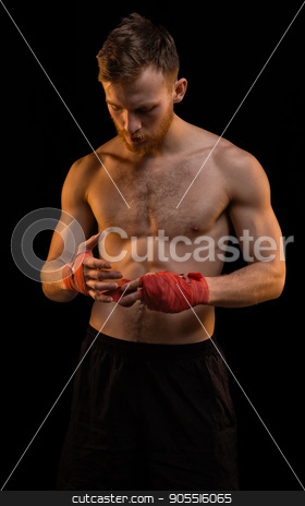Boxer with red boxing bandages stock photo, Boxer with red boxing bandages on black background by Chris Tefme