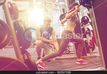 man and woman with barbell flexing muscles in gym stock photo, sport, fitness, teamwork, weightlifting and people concept - young man and personal trainer with barbell flexing muscles in gym by Syda Productions