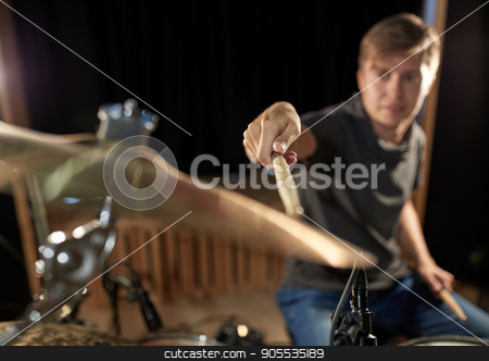 male musician playing drums and cymbals at concert stock photo, music, people, musical instruments and entertainment concept - male musician playing drums and cymbals at concert or studio by Syda Productions