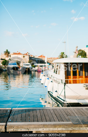 Boats moored on the quay near the old town of Budva, in Monteneg stock photo, Boats moored on the quay near the old town of Budva, in Montenegro, the Adriatic Sea by Nadtochiy
