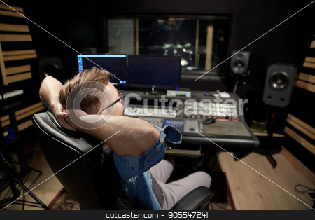 man at mixing console in music recording studio stock photo, music, technology, people and equipment concept - man at mixing console in sound recording studio by Syda Productions