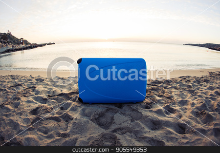 Travel, holiday and vacation concept - blue suitcase on the beach stock photo, Travel, holiday and vacation concept - blue suitcase on the beach by Satura86