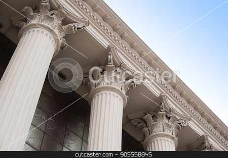 Beautiful columns of the capital on the facade of the historic building stock photo, Beautiful columns of the capital on the facade of the historic building by timonko