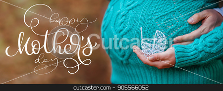 Pregnancy concept: belly with hand holding small toy stroller in front and text Happy mothers day. Calligraphy lettering hand draw stock photo, Pregnancy concept: belly with hand holding small toy stroller in front and text Happy mothers day. Calligraphy lettering hand draw by timonko