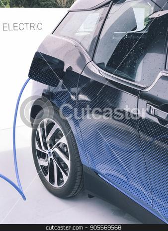 Electric vehicle being plugged in stock photo, Electric vehicle being plugged in or unplugged by Dariusz Miszkiel