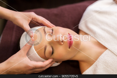 woman having face and head massage at spa stock photo, people, beauty, lifestyle and relaxation concept - beautiful young woman lying with closed eyes and having face and head massage at spa by Syda Productions
