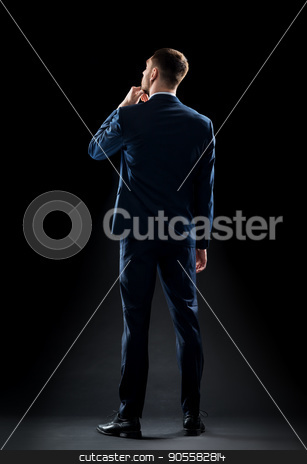 businessman in suit over black stock photo, business, people, formalwear, fashion and office style concept - businessman in suit over black background by Syda Productions