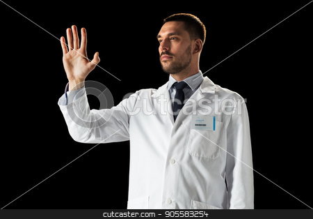 doctor or scientist in white coat stock photo, medicine, science, healthcare and people concept - doctor or scientist in white coat touching something invisible over black background by Syda Productions
