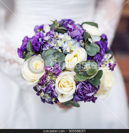 Purple wedding bouquet. stock photo, Beautiful purple wedding bouquet in hands. The bride's bouquet. by Dmitrii Kotin