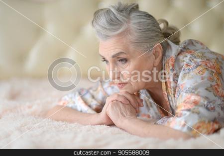 Beautiful sad elderly woman close-up stock photo, Portrait of a beautiful sad elderly woman close-up by Ruslan Huzau